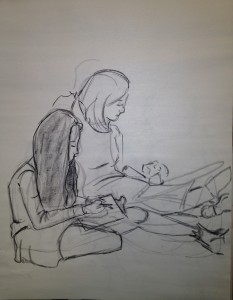 Two ladies drawing the baby