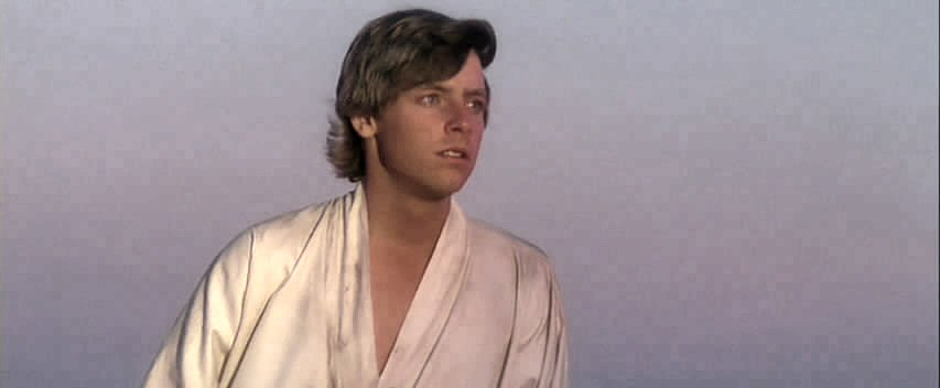 Luke looks across the barren landscape of Tatoonie, longing for adventure.