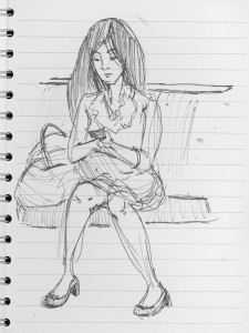 Woman sitting checking her phone
